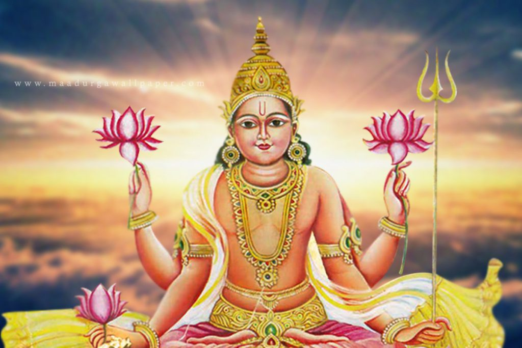 God Surya dev photos holding flowers in hand and sitting in meditation stance